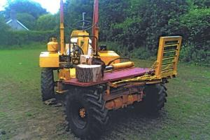 Log splitter built on dumper truck
