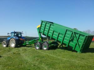 Lewis Hook-lift trailer makes adaptable farm machine towed by tractor