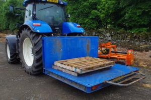 Tractor linkage platform carries, lifts, has livestock sides