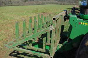 Front mounted frame carries 18 silage films with no damage
